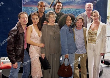"CHRISTIAN Cast members of the Disney animated film ""Altlantis: The Lost Empire,"" gather for a photo before the premiere of the film, in the Hollywood area of Los Angeles. From background left, they are Phil Morris, Don Novello, David Ogden Stiers, front left, Corey Burton, Jacqueline Obrardors, Florence Stanley, Cree Summer, Michael J. Fox, and Claudia Christian"