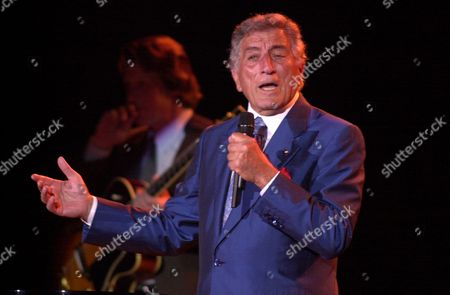 Stock Picture of BENNETT Tony Bennett sings, in Portland, Maine. Bennett and k.d. lang heat up the summer touring season with their 23-city tour which will run through September 15. Bennett celebrates his 75th birthday while on tour on August 3 and will release new album in November featuring duets with Billy Joel, k.d. lang, Stevie Wonder, Ray Charles, B.B. King, Bonnie Raitt, Sheryl Crow, Natalie Cole, Dianna Krall and Kay Starr