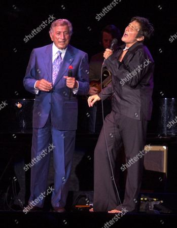 Stock Photo of BENNETT LANG Tony Bennett and k.d. lang sing a duet, in Portland, Maine. Their 23-city tour will run through September 15. Bennett celebrates his 75th birthday while on tour on August 3 and will release new album in November featuring duets with Billy Joel, k.d. lang, Stevie Wonder, Ray Charles, B.B. King, Bonnie Raitt, Sheryl Crow, Natalie Cole, Dianna Krall and Kay Starr