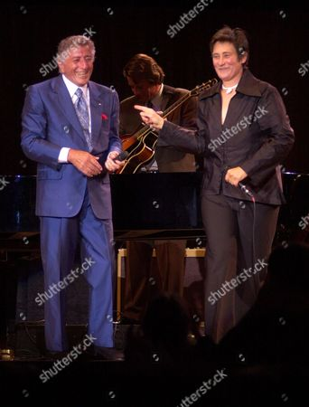 BENNETT LANG Tony Bennett and k.d. lang sing a duet, in Portland, Maine. Their 23-city tour will run through September 15. Bennett celebrates his 75-th birthday while on tour on August 3 and will release new album in November featuring duets with Billy Joel, k.d. lang, Stevie Wonder, Ray Charles, B.B. King, Bonnie Raitt, Sheryl Crow, Natalie Cole, Dianna Krall and Kay Starr