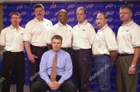 KAISER The Buffalo Bills offensive coaching staff stand behind their head coach, Gregg Williams, seated, as they pose for a group picture after a news conference at the Ralph C. Wilson Stadium complex in Orchard Park, N.Y. on . From left, Mike Sheppard, offensive coordinator; Dan Neal, tight ends; Fred Graves, wide receivers; Steve Kragthorpe, quarterbacks; Ronnie Vinklarek, offensive line;and Tommy Kaiser, special teams assistant