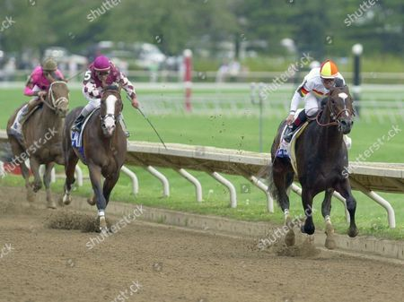DAY Millennium Wind, right, ridden by Laffit Pincay, Jr., charges to the finish line ahead of Songandaprayer (5), with Edgar Prado up, and Dollar Bill, with jockey Pat Day riding, left, to win the $750,000 Toyota Blue Grass Stakes at Keeneland Race Course in Lexington, Ky. Songandaprayer was second, with Dollar Bill third