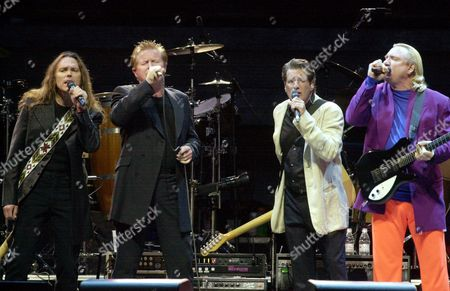 WALSH The Eagles, from left, Timothy B. Schmidt, Don Henley, Glenn Frey, and Joe Walsh perform on stage at Invesco Field during the first event to be held at the new stadium, in Denver. The opening ceremonies for the new facility featured the Eagles and a fireworks show. The new stadium will be the home of the Denver Broncos