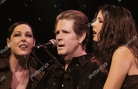 """WILSON Singer Brian Wilson, center, is joined by his daughters, Carnie, left, and Wendy on stage at the 4th Annual Carl Wilson Foundation Benefit Concert at the El Rey Theatre, in Los Angeles, Calif., . Carl Wilson, member of the """"Beach Boys,"""" died from lung cancer in 1998"""