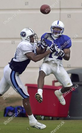 BOOKER Indianapolis Colts wide receiver Terrence Wilkins, right, goes up for a pass as he is defended by Tennessee Titans cornerback Michael Booker, at training camp in Nashville, Tenn., . Wilkins made the reception. The Colts are in Nashville for a three-day combined training camp with the Titans