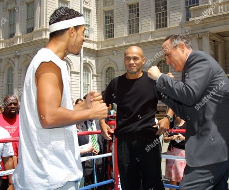 """CAMACHO LEJIA GIULIANI WBA-North America super lightweight champion Hector """"Macho"""" Camacho Jr., left, spars with New York City Mayor Rudolph Giuliani, right, as former WBC super Lightweight champion Jessie James Lejia, center, looks on during a weigh-in, at New York's City Hall. Camacho and Lejia will compete in the Brooklyn Brawlers boxing match at Coney Island on July 7"""