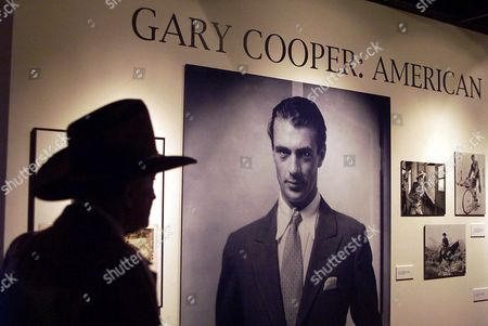 COOPER A man wearing a cowboy hat looks at an exhibit of Gary Cooper memorabilia at The Academy of Motion Picture Arts and Sciences' Centennial Tribute to Gary Cooper, in Beverly Hills, Calif