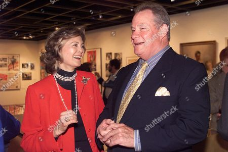 Stock Photo of WAYNE Gary Cooper's daughter Maria Cooper Janis and John Wayne's son Michael Wayne talk at The Academy of Motion Picture Arts and Sciences' Centennial Tribute to Gary Cooper on in Beverly Hills, Calif. Cooper was born May 7, 1901