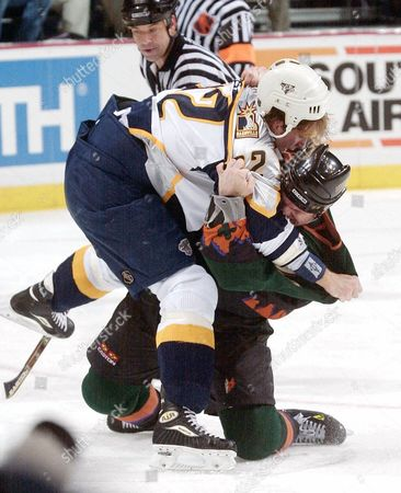 HULSE Phoenix Coyotes' Brad May, bottom, pulls Nashville Predators' Cale Hulse to the ice during a tussle in the second period at the Gaylord Entertainment Center in Nashville, Tenn