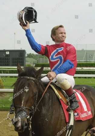 DAY Pat Day tips his helmet to the Churchill Downs crowd after becoming only the third jockey to reach 8,000 career wins when he guided Camden Park to victory in the sixth race, in Louisville, Ky. Day trails only Laffit Pincay Jr. and Bill Shoemaker for all-time wins