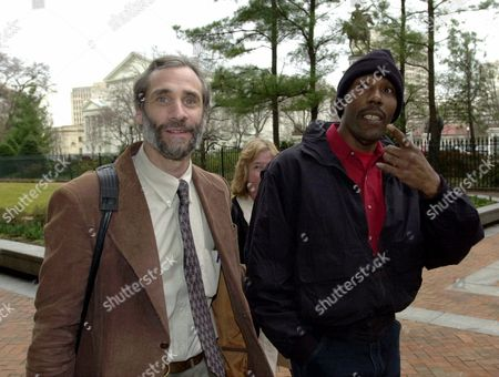 Stock Image of HELLER WASHINGTON Former death row inmate Earl Washington Jr., right, walks into the General Assembly building along with anti-death penalty activist Henry Heller at the Capitol in Richmond, Va., . Washington attended the House Courts of Justice committee meeting that considered a bill dealing with DNA evidence