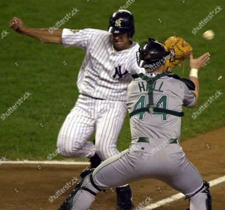 POSADA HALL Tampa Bay Devil Rays catcher Toby Hall takes the throw from left fielder Greg Vaughn as New York Yankees' Jorge Posada scores on an RBI double by Shane Spencer in the second inning, at Yankee Stadium in New York