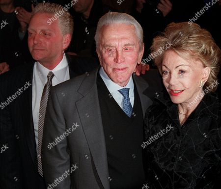 DOUGLAS BUYDENS Actor Kirk Douglas, center, his wife, Anne Buydens, and their son, Eric Douglas, pose for photographers outside the Russian Tea Room, in New York. Kirk Douglas' son, Michael Douglas, and Catherine Zeta-Jones will wed at New York's Plaza Hotel on Saturday, Nov. 18
