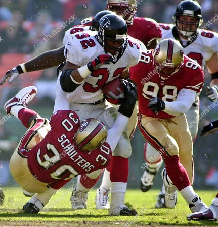 ANDERSON SCHULTERS PETERSON San Francisco 49ers' Lance Schulters (30) and Julian Peterson (98) try to bring down Atlanta Falcons running back Jamal Anderson (32) in the second quarter, in San Francisco
