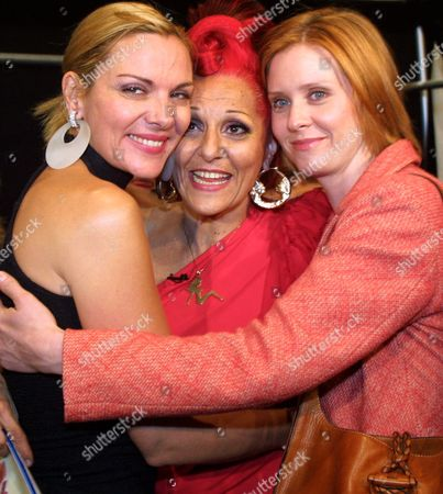 """CATTRALL FIELD NIXON Patricia Field, center, receives a hug from """"Sex and the City"""" co-stars Kim Cattrall, left, who portrays Samantha, and Cynthia Nixon, who portrays Miranda, after the House of Field collection for Spring 2002 fashion show, in New York"""