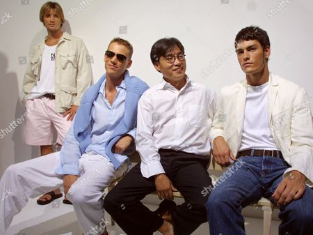 CHU Fashion designer David Chu, center right, joins Alvaro, left, Ryan, second from left, and Tyson, during the showing of his Spring 2002 Collection in New York, . Alvaro wears a stone safari jacket over a white cotton tank and pink linen/cotton pleated short; Ryan wears a blue cotton ribbed crewneck sweater, blue linen one-piece collar shirt and a white cotton drawstring pant; and Tyson wears a natural double-faced linen single-breasted blazer over white cotton boatneck T-shirt and washed denim jean