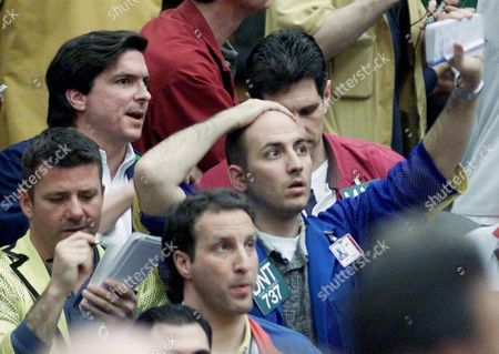 Stock Picture of FEDERIGHI STERN Traders Dante Federighi, right, and Mark Stern, center foreground, watch monitors on the floor of the Eurodollar Futures pit at the Chicago Mercantile Exchange Tuesdsay, as the Federal Reserve announced a half-point drop in a key interest rate, hoping to encourage Americans to spend and invest to revive a sluggish economy