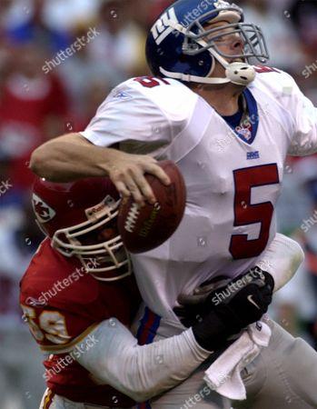 EDWARDS COLLINS Kansas City Chief's linebacker Donnie Edwards (59) sacks New York Giants quarterback Kerry Collins (5) in the third quarter, at Arrowhead Stadium in Kansas City, Mo. The Giants won 13-3