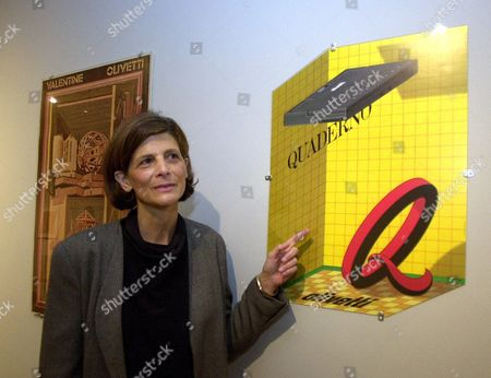 """HIESINGER Curator Kathy Hiesinger explains a 1992 poster by Milton Glaser at the Philadelphia Museum of Art in Philadelphia, . """"Milton Glaser Graphic Design: Design Influence and Process,"""" on display at the museum from Nov. 15 to Jan. 21, traces the wanderings of the man who is often called the Picasso of design"""