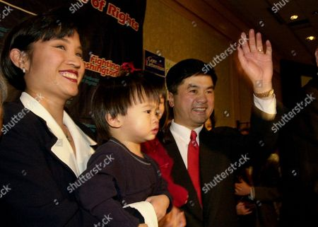 LOCKE Washington Gov. Gary Locke waves to the crowd as he heads toward the podium for an acceptance speech before Washington state Democrats, in Seattle. At left is Locke's wife, Mona Lee Locke, holding their son Dylan