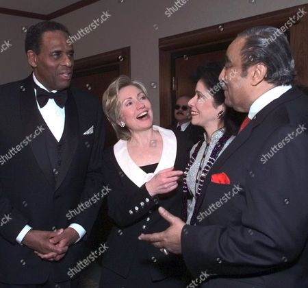 CLINTON Gubernatorial candidate and New York State Comptroller Carl McCall, left, visits with Sen. Hillary Rodham Clinton, D-N.Y., left center, Joyce Brown, McCall's wife, right center, and Rep. Charles B. Rangel, D-N.Y.,, before McCall gave the keynote address at the New York State Black and Puerto Rican Legislators dinner in Albany, N.Y