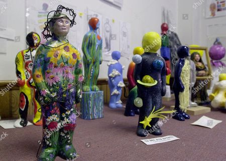 Stock Picture of Maquettes of sculptures of the Omaha J. Doe project are on display in Omaha, Neb. . The Omaha J. Doe project, the brainchild of local artists, features 100 wildly decorated six-foot genderless human statues that will line Omaha sidewalks this coming May