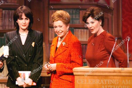 """BUSH HIGGINS CLARK Laura Bush, right, greets authors Carol Higgins Clark, left and Mary Higgins Clark, center, at the conclusion of a """"Celebration of American Authors"""" inaugural event in Washington, Friday, Jan, 19, 2001"""