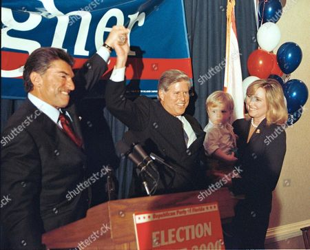 GALLAGHER Al Cardenas, chairman of the Republican Party of Florida, left, lifts Tom Gallagher's hand while announcing Gallagher's victory in the race for Florida Insurance Commissioner, in Tallahassee, Fla. At right is the candidate's wife Laura and their son Charlie