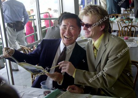TAKEI BROCHTRUP Actors George Takei, left, from Star Trek, and Bill Brochtrup, of NYPD Blue, look over a program at the Kentucky Derby at Churchill Downs, in Louisville, Ky