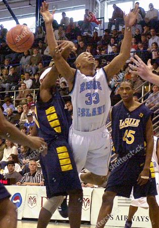 Stock Photo of JONES MARBURY BUTLER La Salle's Dwayne Jones, left, fouls Rhode Island's Zach Marbury (33) as Rasual Butler (45) looks on during the first half, in Kingston, R.I