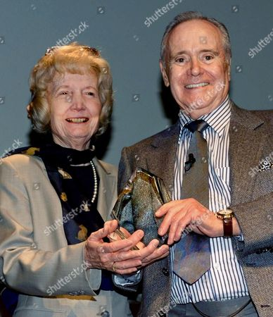 """TRACY LEMMON Actor Jack Lemmon and Susie Tracy, daughter of late actor Spencer Tracy, pose with the 12th annual Spencer Tracy Award, presented to Lemmon """"in recognition of his outstanding screen performances and professional achievement,"""" in ceremonies, at UCLA's Royce Hall in Los Angeles. Lemmon was honored for his over four-decade career in films that runs the gamut from light comedy to heavy drama, winning two Oscars from eight Academy Award nominations, and many foreign awards"""