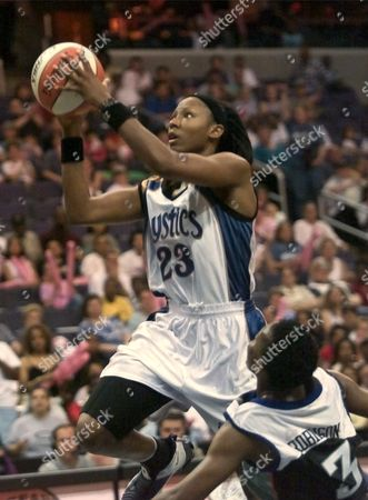 HOLDSCLAW ROBINSON Washington Mystic's Chamique Holdsclaw (23) goes up for two as New York Liberty's Crystal Robinson (3) falls to the ground during the second half, in Washington. The Liberty went on to defeat the Mystic's 81-80. Holdsclaw led all scorers with 31 points