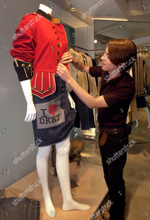 BORGO Visual merchandise coordinator Eddie Borgo styles a mannequin with the lastest fashions by Donna Karan at Karan's DKNY flagship Madison Avenue store in New York . France's LVMH Moet Hennessey Louis Vuitton SA announced Monday it will buy famed U.S. fashion house Donna Karan International Inc. for $243 million, adding another household name to LVMH's stable of luxury products