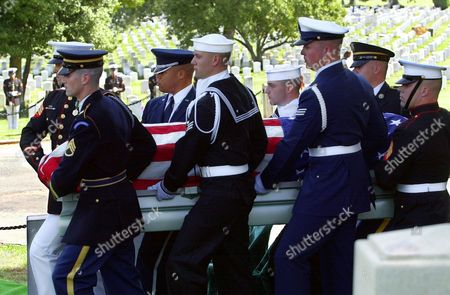 A military honor guard carries the casket of former Senate Majority Leader Mike Mansfield during funeral services at Arlington National Cemetery in Arlington, Va