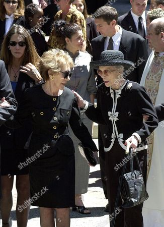 REGAN WYMAN Former first lady Nancy Reagan, left, speaks with Jane Wyman, right, after memorial services for Maureen Reagan at the Cathedral of the Blessed Sacrament in Sacramento Calif., . In background, left, is Patti Reagan, and upper right Ron Reagan Jr