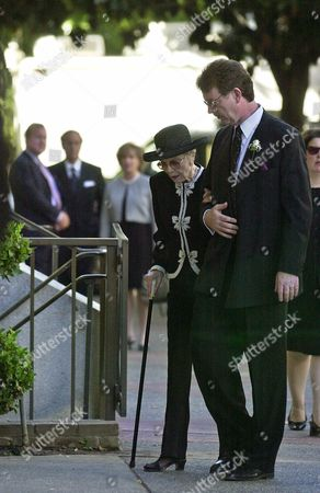 Stock Picture of WYMAN REVELL Maureen Reagan's husband Dennis Revell escorts Reagan's mother Jane Wyman on their arrival for memorial services for Maureen Reagan, at the Cathedral of the Blessed Sacrament in Sacramento Calif. Reagan, 60, died Aug. 8 at her Granite Bay home after a nine-month battle with skin cancer that progressed from a melanoma diagnosis in 1996 to tumors in her hip and brain