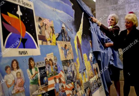 Stock Photo of CORRIGAN PETERSON Grace Corrigan, center right, mother of Christa McAuliffe, and Pam Peterson, right, west regional director for the Challenger Center of Space Science Education, unveil a mural about the life of McAuliffe during ceremonies at Framingham State College in Framingham, Mass., . The unveiling was part a commemoration held at the school on the 15th anniversary of McAuliffe's death in the space shuttle Challenger disaster