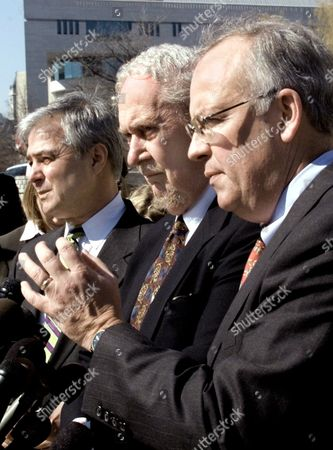 PETTIT BORK STARR Former Independent Counsel Kenneth Starr, right, accompanied by Mike Pettit, left, and Robert Bork, answers a reporter's question outside federal court in Washington, during a break in the Microsoft hearing. The three represent a group of Microsoft competitors