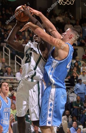 LANG RICHARDSON BOOKER North Carolina's Kris Lang, right, blocks the shot of Michigan State's Jason Richardson but is called for body contact foul in the second half, in East Lansing, Mich. At left is North Carolina's Michael Booker. The third-ranked Spartans beat No. 6 North Carolina 77-64