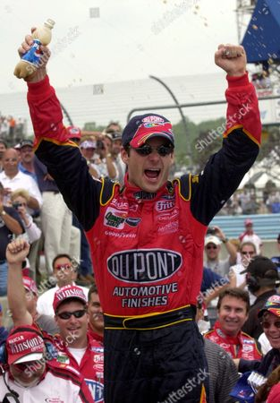 GORDON Jeff Gordon celebrates after winning his fourth NASCAR Winston Cup Global Crossing in five years at Watkins Glen International in Watkins Glen, N.Y., . The three-time Winston Cup champion won for the seventh time on a road course, breaking a tie with Rusty Wallace, Richard Petty and Bobby Allison for the most in NASCAR history