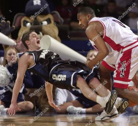 MILLER ARENAS Butler guard Brandon Miller, left, falls backward after drawing an offensive foul on Arizona guard Gilbert Arenas during the first half of their NCAA second round game in Kansas City, Mo