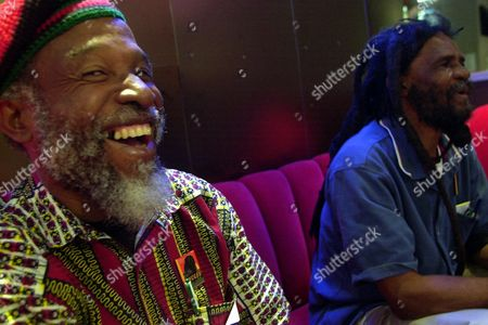 """Stock Image of Cedric Brooks, Johnny Moore Jamaican musician Cedric Brooks, left, laughs next to Ska pioneer Johnny """"Dizzy"""" Moore as they talk about their days at the Alpha Boys School in Kingston, Jamaica at the Experience Music Project in Seattle, Washington. One of Brooks' sisters, Paulette Keise, said he died of cardiac arrest at New York Hospital Queens. He was 70. Brooks began his music career in the late 1960s as a studio musician, playing in songs such as Burning Spear's """"Door Peep."""" He also had hits with trumpet player David Madden including """"Money Maker"""" and """"Mystic Mood."""" Brooks also was a member of the Jamaican ska band The Skatalites"""