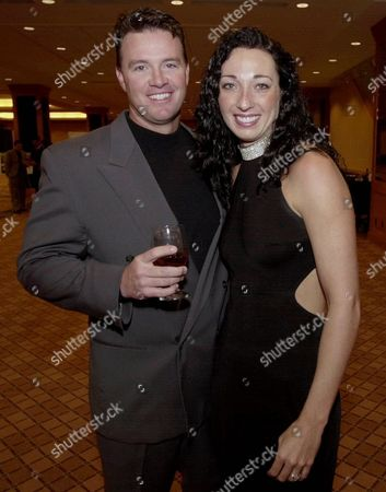 ROUEN Six-time Olympic gold medalist swimmer Amy Van Dyken, right, and Denver Broncos punter Tom Rouen pose before going into the Colorado Sports Hall of Fame dinner in Denver. Van Dyken has a severed spine after an accident on her all-terrain vehicle in Arizona. A hospital spokeswoman didn't provide details Monday on the injuries. The swimmer was hurt Friday night, June 6, 2014, and told emergency workers at the scene she could not move her toes or feel anything touching her legs