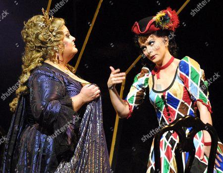 "VOIGT PETROVA Deborah Voigt, left, as ""Ariadne,"" and Lyubov Petrova as ""Zerbinetta"" perform during a dress rehearsal of Richard Strauss' opera ""Ariadne auf Naxos"", at New York's Metropolitan Opera. Petrova makes her debut at the Metropolitan Opera Saturday, April 14"