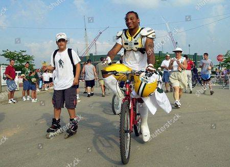 FERGUSON Green Bay Packers' second round draft choice, Robert Ferguson, smiles as he rides a bike to training camp, in Green Bay, Wis