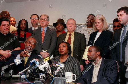 Stock Image of ROLLINGS Walter Beach III, seated left, an employee of the New York City Parks and Recreation Department, speaks at a news conference, in New York, joined by colleagues Kathleen Walker, seated center, and Robert Wright, seated right. A federal commission has found evidence that New York City's Department of Parks and Recreation discriminated against its employees on the basis of race and nationality. Standing directly behind those seated are, from left, employee Henry Roman, and attorneysfor the employees Louis Steel, red tie, Myron Beldock and Cynthia Rollings