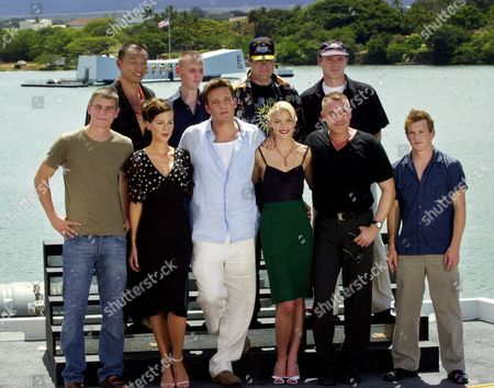 "BECKINSALE With Arizona Memorial as a backdrop the cast of the ""Pearl Harbor"" film, upper row left to right, Cary-Hiroyuki Tagawa, Ewen Bremner, Dan Aykroyd, Colm Feore; bottom row left to right, Josh Hartnett, Kate Beckinsale, lead actor Ben Affleck, James King, Tom Sizemore and William Lee Scott, are joined for a cast photo on the flight deck of USS John C Stennis aircraft carrier, in Pearl Harbor, Hawaii. The film premieres on the warship on Monday and opens next weekend"