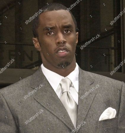 """COMBS Sean """"Puffy"""" Combs leaves New York State Supreme Court, in this photo. Combs isn't letting jury deliberations in his weapons and bribery trial stop him from having a good time. Combs and his entourage were at Radio City Music Hall Thursday night, March 15, enjoying a concert by Grammy nominee Jill Scott and Carl Thomas, who is signed to Combs' Bad Boy record label"""