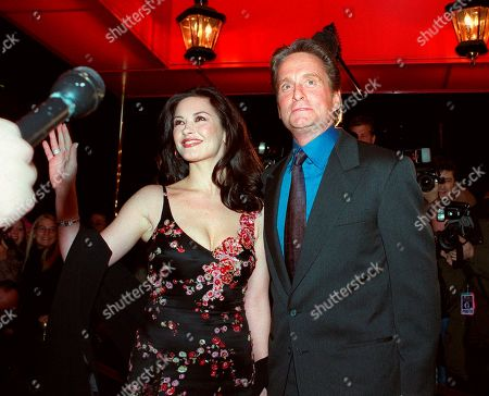 ZETA JONES DOUGLAS Actor Michael Douglas, and his fiancee, actress Catherine Zeta-Jones, pose for photographers outside the Russian Tea Room, in New York. Glitz overtook privacy when these two brought old-fashioned glamour back for their swanky 2000 wedding. They married at The Plaza Hotel, drawing several hundred gawkers who craned to see inside arriving limos