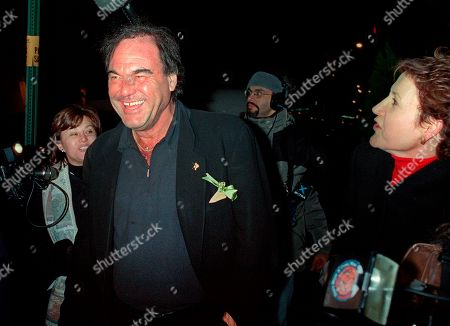 STONE American film director Oliver Stone laughs as he is approached by members of the media while leaving New York's Plaza Hotel, after attending the wedding of actor Michael Douglas and actress Catherine Zeta-Jones. Glitz overtook privacy when Douglas and Zeta-Jones brought old-fashioned glamour back for their swanky 2000 wedding. They married at The Plaza Hotel, drawing several hundred gawkers who craned to see inside arriving limos
